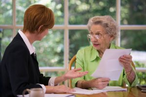 Senior woman meeting with agent